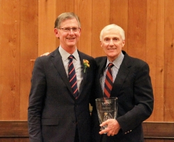 Charles Sorenson, MD (left) accepts Distinguished Service to Healthcare Award from UHA President/CEO Greg Bell.